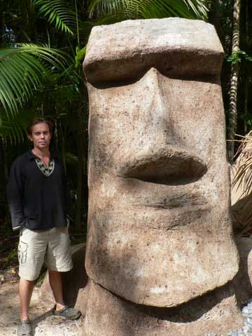 rob lapaer and one of his massive moai concrete sculptures